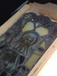 Stained Glass panel depicting St Hilda removed from the Abbey Church for Conservation